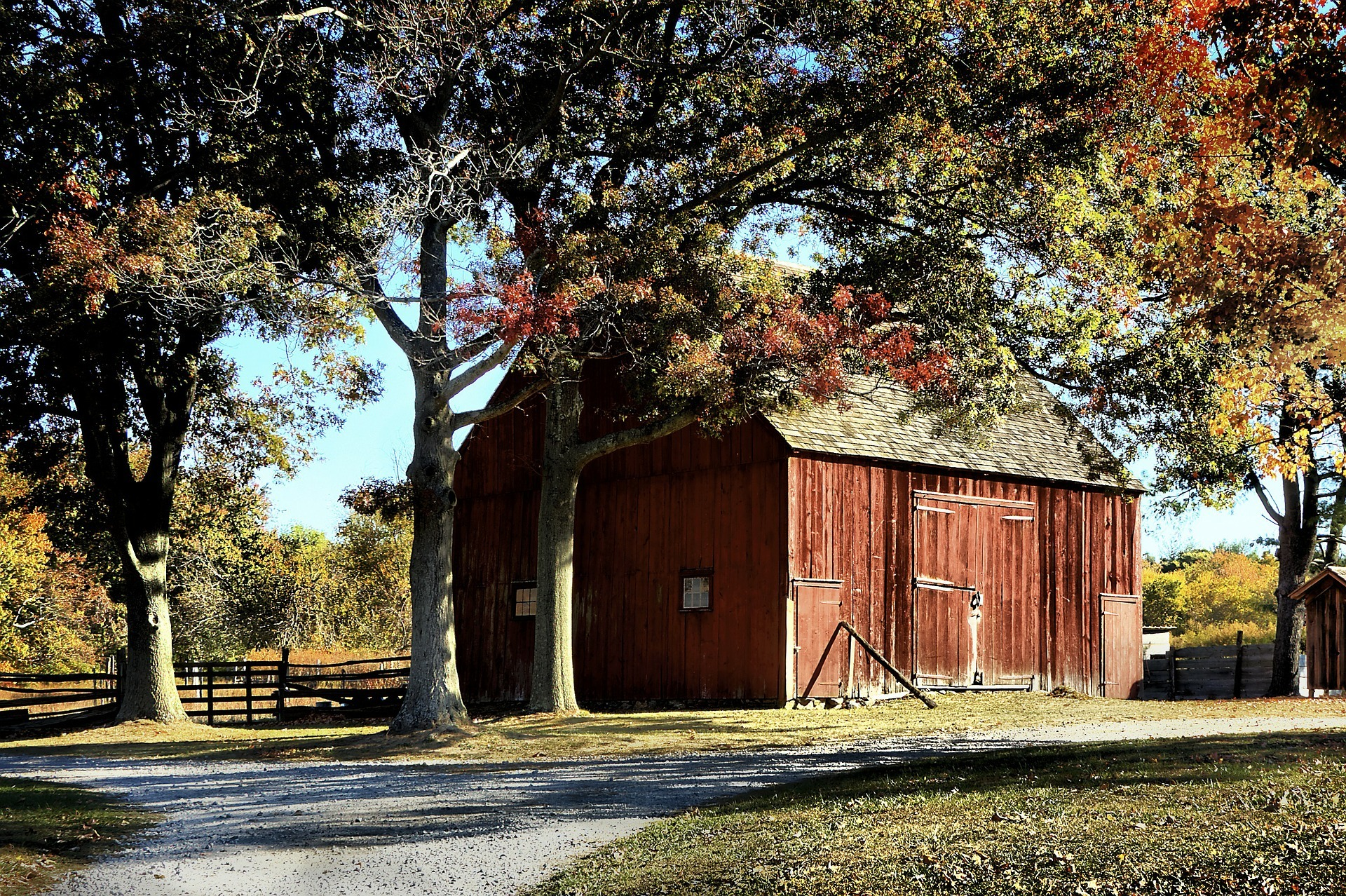 Red Barn Surrounded by Trees During the Fall - Farm Background Wallpaper Pictures
