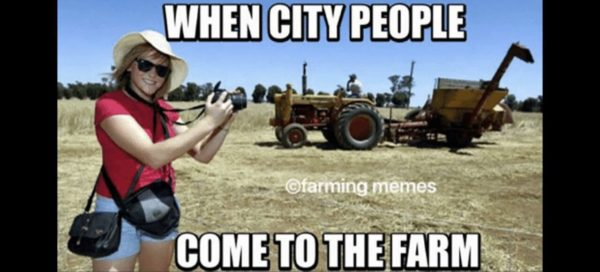 When City People Come to the Farm - Farming Memes - Girl Taking Pictures of a Tractor Image